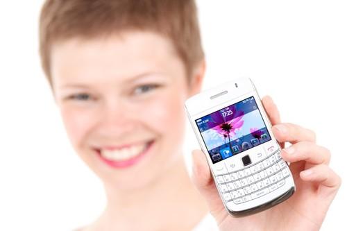 WomanShowingACellPhone-PetrKratochvil.jpg