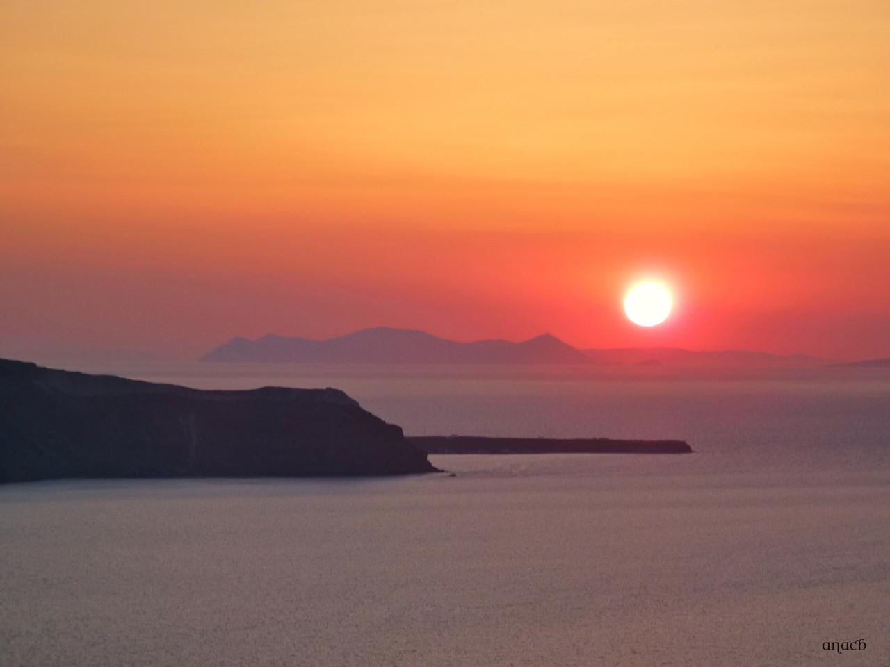 Santorini-o pôr-do-sol visto de Fira (1544) cópi